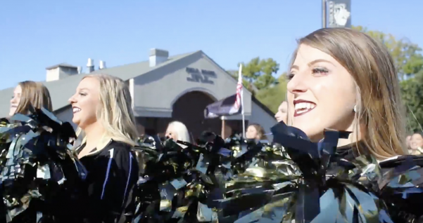 Junior Brady Smith dances during the homecoming parade alongside her teammates. Smith's homecoming story is the first of our three-part narrative.  Photo by Kayla Drake