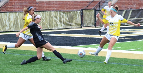 During a home game on Oct. 14, Lindenwood forward Maggie Miller struggles against Fort Hays State's Chloe Montano (26) and Zariah Smith (28).   Photo by Caleb Riordan.