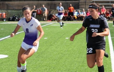 In a game against Southwest Baptist University, Lindenwood senior Olivia Callipari (right) fights with Tessa Wagner for posession at midfield.  Lindenwood won the contest 3-1 on Sept. 30. <br /> Photo by Caleb Riordan.