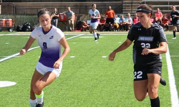 In a game against Southwest Baptist University, Lindenwood senior Olivia Callipari (right) fights with Tessa Wagner for posession at midfield.  Lindenwood won the contest 3-1 on Sept. 30.  Photo by Caleb Riordan.