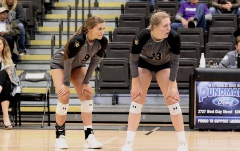 Hannah Borchelt (9) and Kat Finnerty (13) observe as Missouri Southern State prepares to serve on Saturday, Nov. 3 at Hyland Arena. <br /> Photo by Merlina San Nicolás.