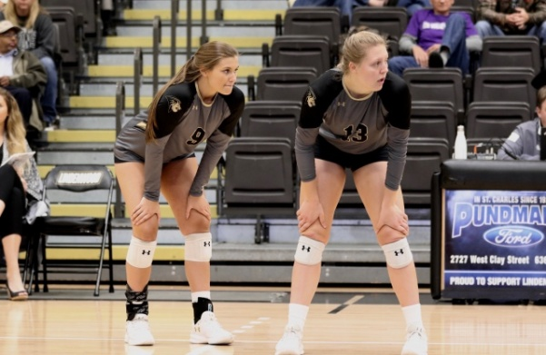 Hannah Borchelt (9) and Kat Finnerty (13) observe as Missouri Southern State prepares to serve on Saturday, Nov. 3 at Hyland Arena.  Photo by Merlina San Nicolás.