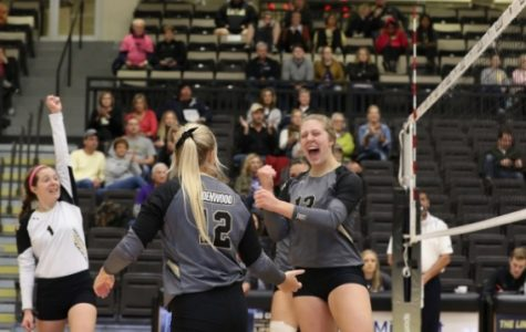 Sara Wagenknecht (1), Allyson Clancy (12) and Kat Finnerty (13) celebrate a winning point against Southwest Baptist University.   Lindenwood swept the Bearcats on Nov. 2 at Hyland Arena.  Photo by Merlina San Nicolás