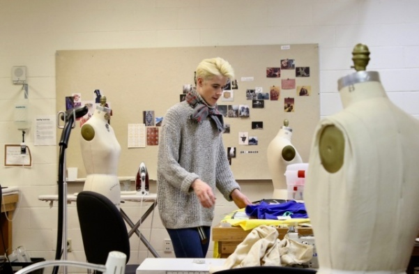 Adam Brewster, 22, works on his pieces at the fashion studio in Scheidegger on Friday, Nov. 16. Brewster is a senior and will present his line