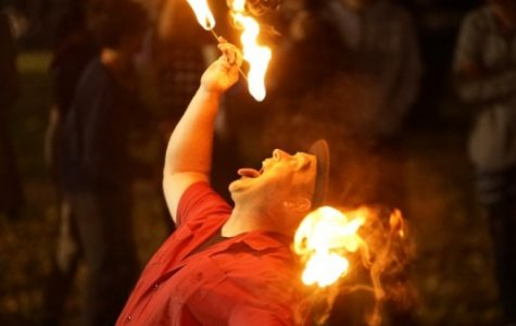 Professional entertainer Joshua Routh performs a fire-swallowing act during the Dark Carnival. <br> Photo by Mitchell Kraus
