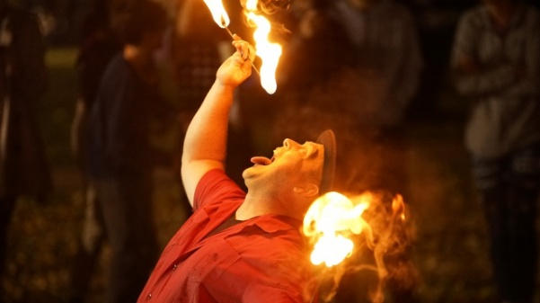 Professional entertainer Joshua Routh performs a fire-swallowing act during the Dark Carnival.  Photo by Mitchell Kraus