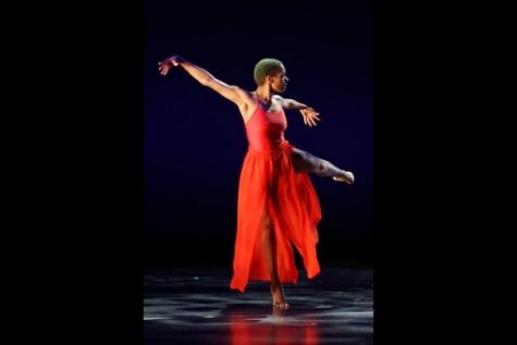 "Tiala Taylor performs part of ""Dissent"" at the fall 2018 dance concert.  Photo by Mitchell Kraus"