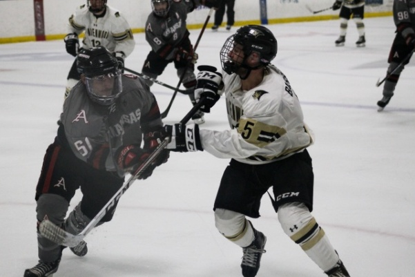 Freshman Blair Barrows (right) clashes with Razorbacks defender Dominic de la Guardia Saturday night in the Lindenwood Ice Arena.   Photo by Kayla Bakker.