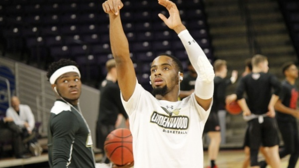 TJ Crockett (left) looks to see if Brad Newman (center) made a free throw as they warm up before the game against Minnesota State University, on Nov. 9. Newman lead the team for points scored during the game.  Photo by Scott Mandziara