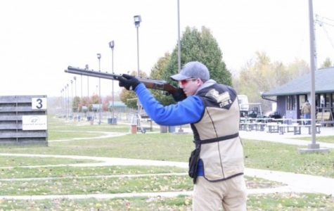 Sophomore Brandon Stone sets up for a shot at Gateway Gun Club in Bridgeton, Missouri, on Nov. 9. <br> photo by Taylor McDaniel