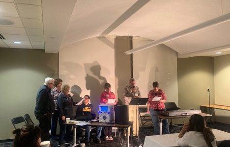 Volunteers and international students performing during the open mic night hosted by International Student Fellowship on November 28 at Evans Commons. <br> Photo by Sandy Leegumjorn