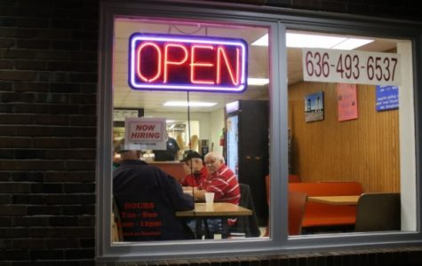 A 5 a.m. regular since 1973, Frank Childress looks out the window. Donut King reopened in March 2018.  <br>Photo by Kayla Drake