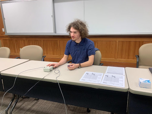 Brenden Roland hosting the quiz bowl on Nov. 20, 2018 at Harmon Hall in the Dunseth auditorium.  Photo by Sandy Leegumjorn