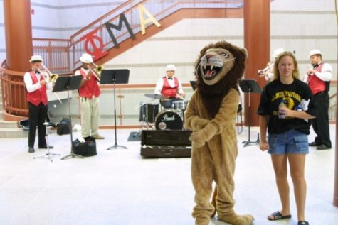 Leo the Lion at the grand opening of the Spellmann center, one of the nine buildings constructed on campus during the Dennis Spellmann administration.  <br> Photo from the Mary Ambler Archives.