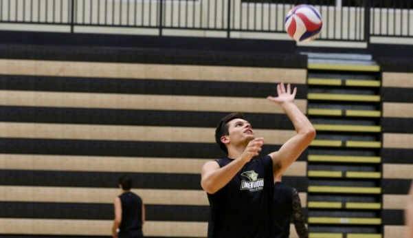 Brian Schwob spikes a ball during a practice in October of last year at the Hyland Arena.  Photo by Merlina San Nicolás
