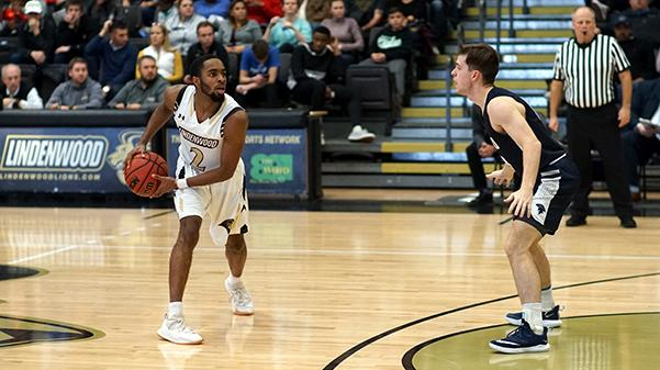 Senior+Brad+Newman%2C+%232%2C+was+the+had+a+career+best+performance+at+Thursday%27s+game%2C+scoring+41+points.+File+photo+from+a+game+against+Missouri+Baptist+earlier+in+the+season.+%3Cbr%3E+Photo+by+Mitchell+Kraus