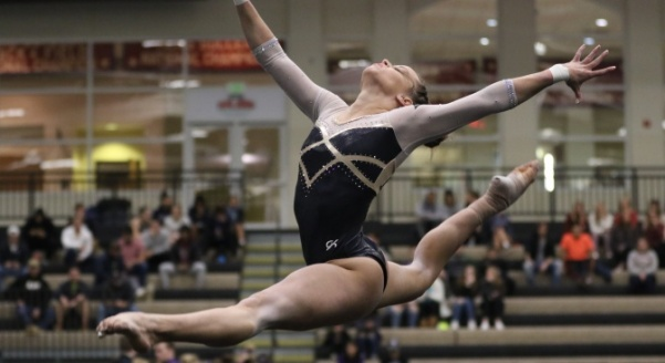 File+photo%3A+Sophomore+Courtney+Mitchell+performs+her+floor+routine+in+a+meet+against+Winona+State+University+on+Jan+18.+Courtney+earned+the+top+score+overall+in+three+out+of+the+four+events.%0A%3Cbr%3E+Photo+by+Kayla+Drake