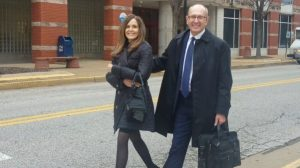 Michael Shonrock and his wife walk away from the St. Charles County courthouse on Thursday Feb. 7. He yelled
