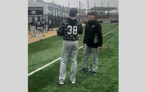 Assistant coach Zac Pearman, right, speaks with Lindenwood pitcher Brody Roach. Pearman graduated from Lindenwood in 2014.
