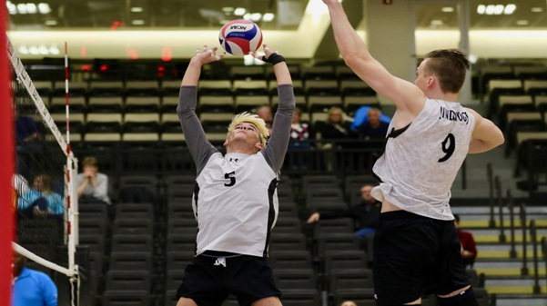 File photo: Adam Brewster (5) sets the ball during a match against Quincy University on Feb. 20 at Hyland Arena.  Photo by Merlina San Nicolás