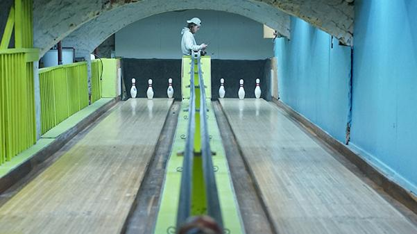 Pinsetter Brendan Sportsman stands at the back of the lanes beneath St. Charles' oldest bar.  Photo by Mitchell Kraus