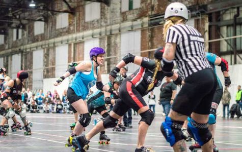 Scoring points for the St. Chux Derby Chix, Sarah Ryerson, aka Rainbow Crash (No. 125), rushes past the defense for the Midstate Mayhem Roller Derby on March 2 at Olympia Athletics & Events Center in St. Charles. <br> Photo by Andria Graeler