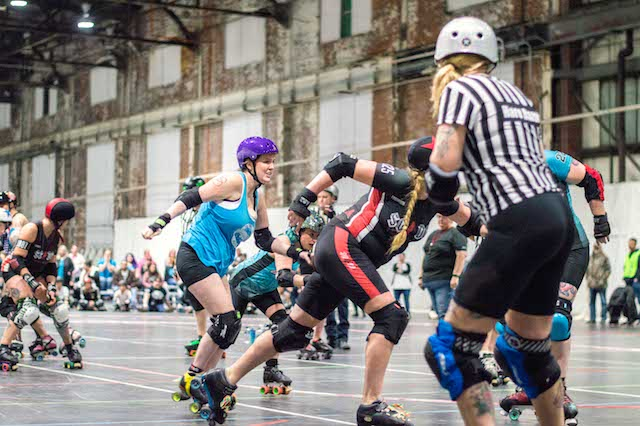 Scoring+points+for+the+St.+Chux+Derby+Chix%2C+Sarah+Ryerson%2C+aka+Rainbow+Crash+%28No.+125%29%2C+rushes+past+the+defense+for+the+Midstate+Mayhem+Roller+Derby+on+March+2+at+Olympia+Athletics+%26+Events+Center+in+St.+Charles.++Photo+by+Andria+Graeler