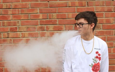 Lindenwood student Seth Cushman takes a vape break on Main Street in St. Charles. <br> Photo by Lindsey Fiala