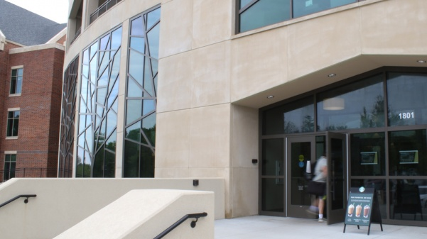 A student enters the Library and Academic Resources Center.
