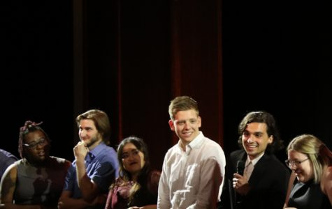 "Leonardo Panziera (second from right) speaks after the screening.  Panziera intends to graduate in December, and his capstone film, ""Camellia,"" won an audience's choice award for cinematography.  <br> Photo by Matt Hampton"