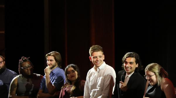 "Leonardo Panziera (second from right) speaks after the screening.  Panziera intends to graduate in December, and his capstone film, ""Camellia,"" won an audience's choice award for cinematography.   Photo by Matt Hampton"
