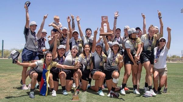 The Lindenwood women's rugby team celebrates with the trophy after their national championship win.  Photo by USA Rugby.