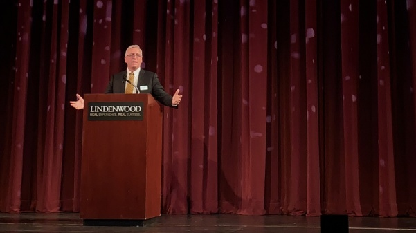 John Porter, Lindenwood's next president, speaks on Thursday, July 27, in the Lindenwood Theater.