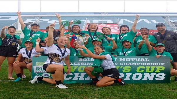 The+women%27s+rugby+team+celebrates+with+the+trophy+after+winning+the+triple+crown+for+a+second+year+in+a+row+and+third+national+title+in+2019.+%3Cbr%2F%3E+Photo+by+USA+Rugby.+