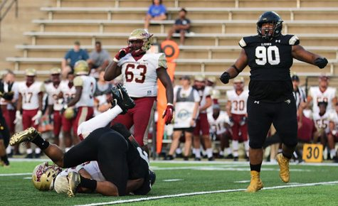 File photo: Lindenwood defensive lineman Dwight Dantzler celebrates as fellow lineman, Uchenna Egwuonwu sacks Midwestern