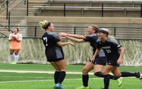Emily Jowers embraces Ava Burke (7) after the lone goal of the match to give Lindenwood the win against Lewis University on Sunday afternoon. <br/> Photo by Billy Woods.