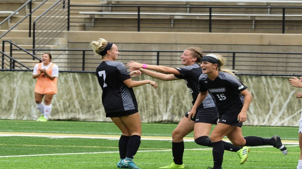 Emily Jowers embraces Ava Burke (7) after the lone goal of the match to give Lindenwood the win against Lewis University on Sunday afternoon.  Photo by Billy Woods.