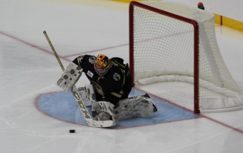 Goalie Sophie Wolf from Ontario blocks a shot during the game opener of the season against the University of Wisconsin on Friday night at the Centene Ice Community Arena.