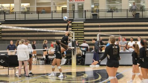 The womens volleyball team practice their spikes before starting competition against Cedarville University on Sep. 13 at Hyland Arena.