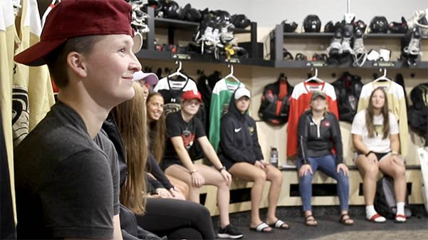 Jane Jacobs and the rest of the women's hockey team listen to head coach Shelley Looney share her excitement for the new season.