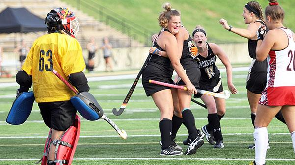 Lindenwood's Pauline Terwindt (facing camera) hugs teammate Taylor Sullivan as Lauren Roberts (11) and Bridget Hoogendijk join in the celebration after Sullivan's first-period goal Friday night against Frostburg State. The Lions won 3-1.