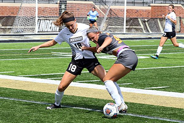 Lions defender Alaina White battles for ball control against Tritons midfielder Katelyn Grandcolas. Lindenwood lost to University of Missouri-St. Louis 1-0.