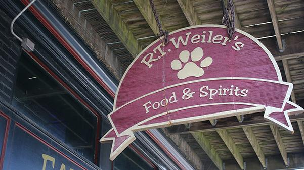 The sign in front of R.T. Weilers on Main Street.  The building's facade bears the words