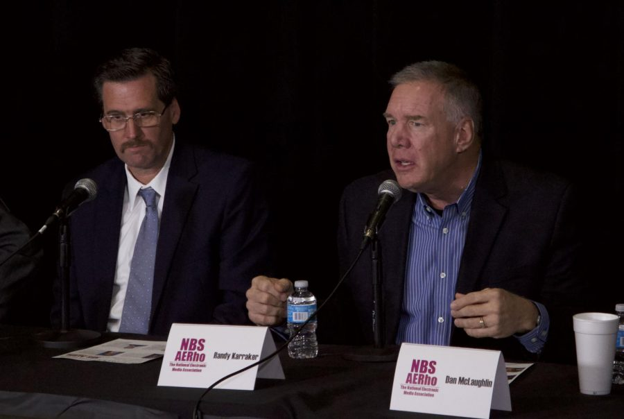 Randy Karraker (right) addresses the audience during the homecoming alumni panel on Oct. 11.