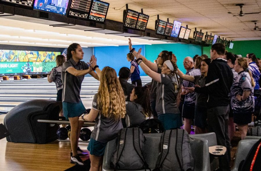 Serenity Quintero high-fives her teammates during competition on Saturday at Plaza Lanes.