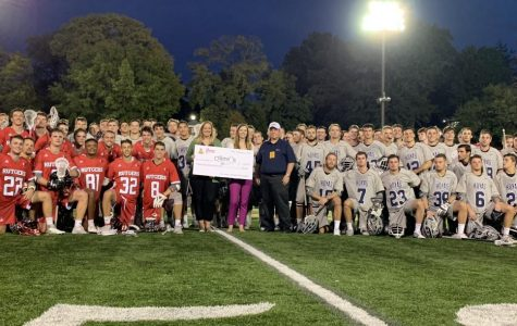 Georgetown University and  Rutgers University pose with the check that was given to Children's Hospital.<br> Photo provided by William Stark.
