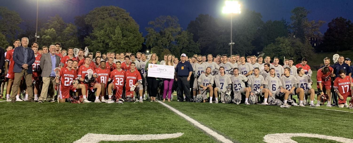 Georgetown University and  Rutgers University pose with the check that was given to Children's Hospital.  Photo provided by William Stark.