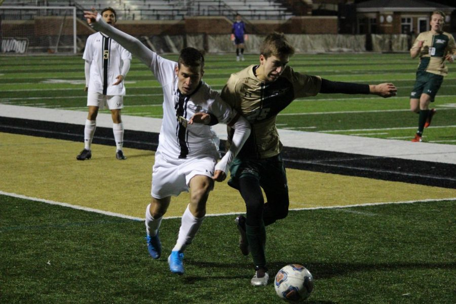 No. 10 Leon Silva fights with a Missouri S&T defender for possession during a match at Harlen C. Hunter Stadium on Oct. 13.