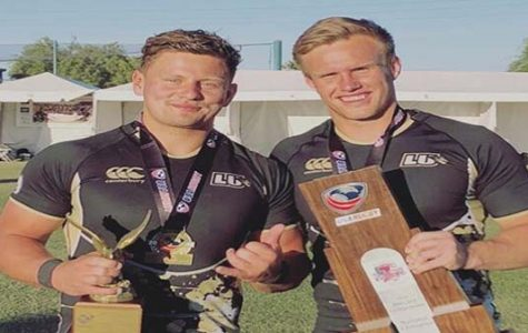 Wesley White and Michael de Waal pose for a photo with their trophies and recognitions after winning the rugby national championships for the third year in a row in May. <br/> Photo taken from de Waal's instagram.