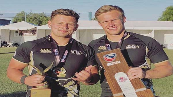 Wesley+White+and+Michael+de+Waal+pose+for+a+photo+with+their+trophies+and+recognitions+after+winning+the+rugby+national+championships+for+the+third+year+in+a+row+in+May.+%3Cbr%2F%3E+Photo+taken+from+de+Waal%27s+instagram.+
